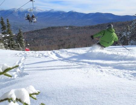 BrettonWoods-01-14-15 green skier in powder-MarkPhoto